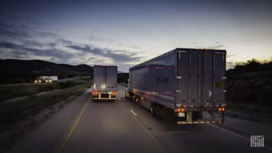 Two tractor-trailers from UPS Freight on the highway. TFI has closed its acquisition of UPS Freight.