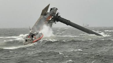 Coast Guard crew searching for missing crew members of the capsized SEACOR Power lift boat.