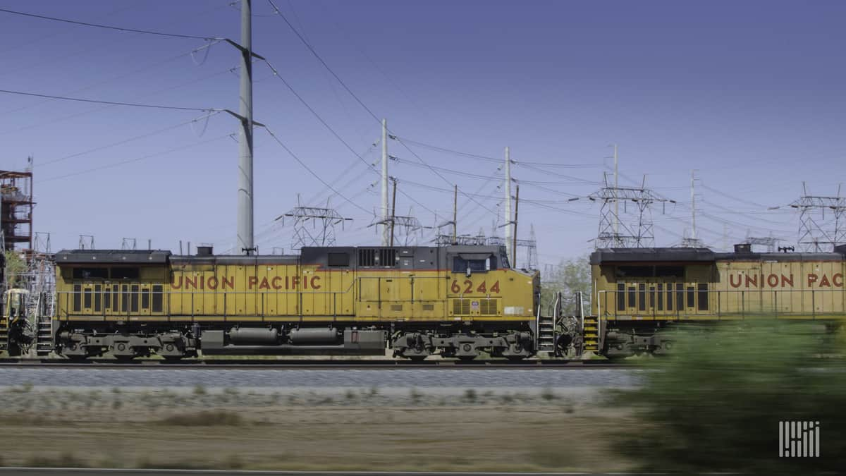 A photograph of two Union Pacific locomotives parked in a rail yard.