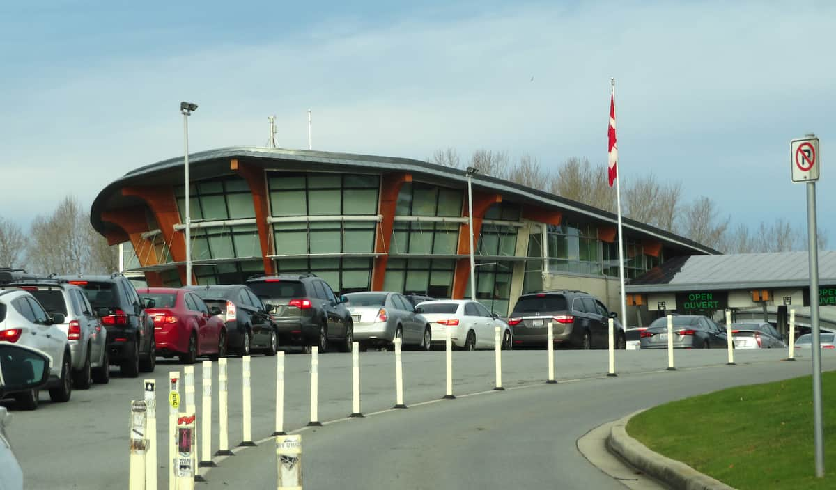 A view of cars lining of at the Watson US-Canada border crossing to illustrate an article about a trucker arrested on drug charges at that border crossing.