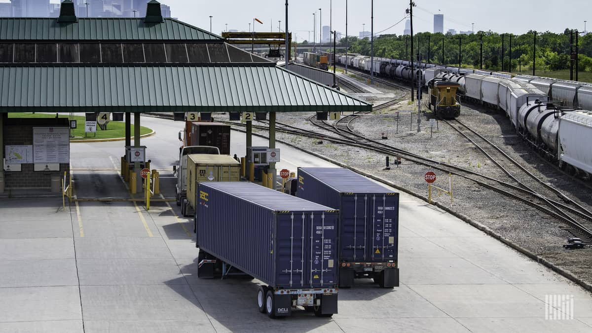 Trucking hauling intermodal containers to illustrate cybersecurity threats to the supply chain.