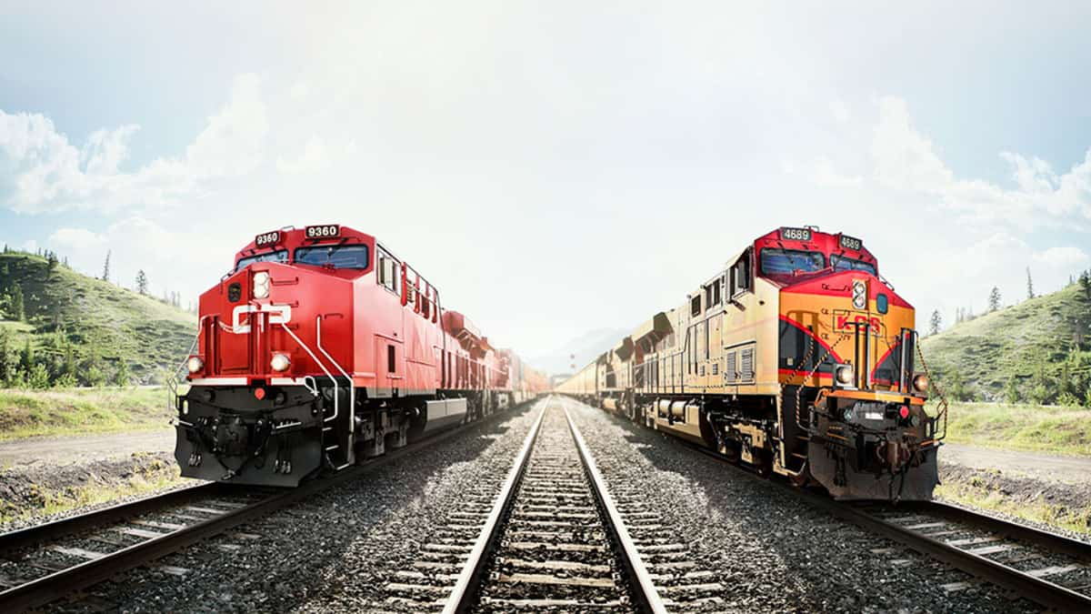 A photograph of two locomotives. One is from Canadian Pacific and the other is from Kansas City Southern.