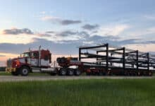 A tractor-trailer of a Mullen Group carrier during a sunset to illustrate an article about the company CEO's comments on the Canadian freight market.