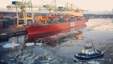 A container ship docked at the Port of Montreal, where longshoremen are set to begin a partial strike.