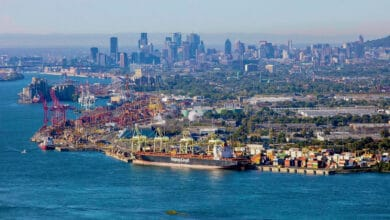 A few of the Port of Montreal and the city skyline behind it.