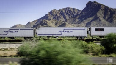 A photograph of a train carrying intermodal trailers.