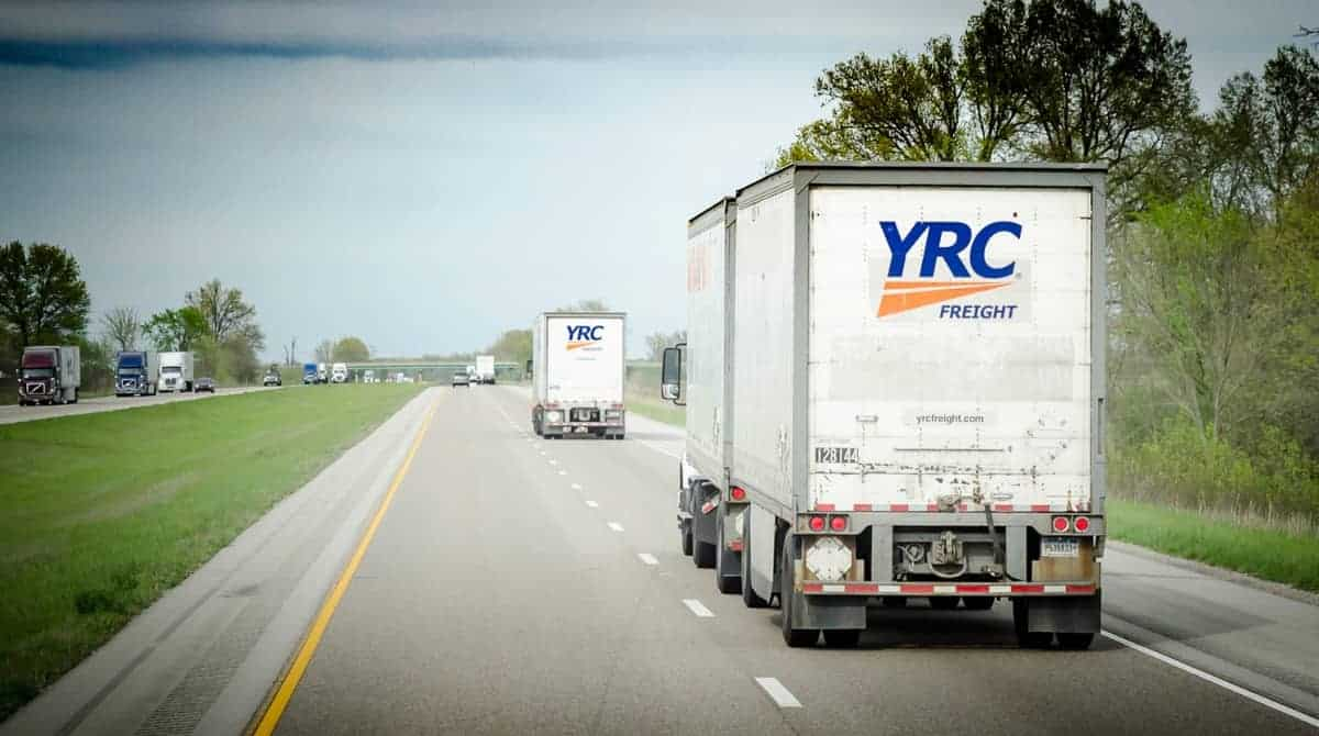 Two YRC-branded trucks move down the road. (Photo: Jim Allen/FreightWaves)