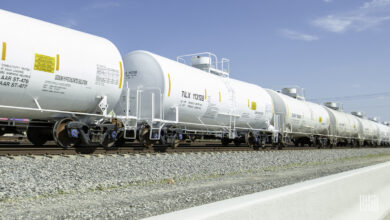 A photograph of tank cars rolling down a railroad track.