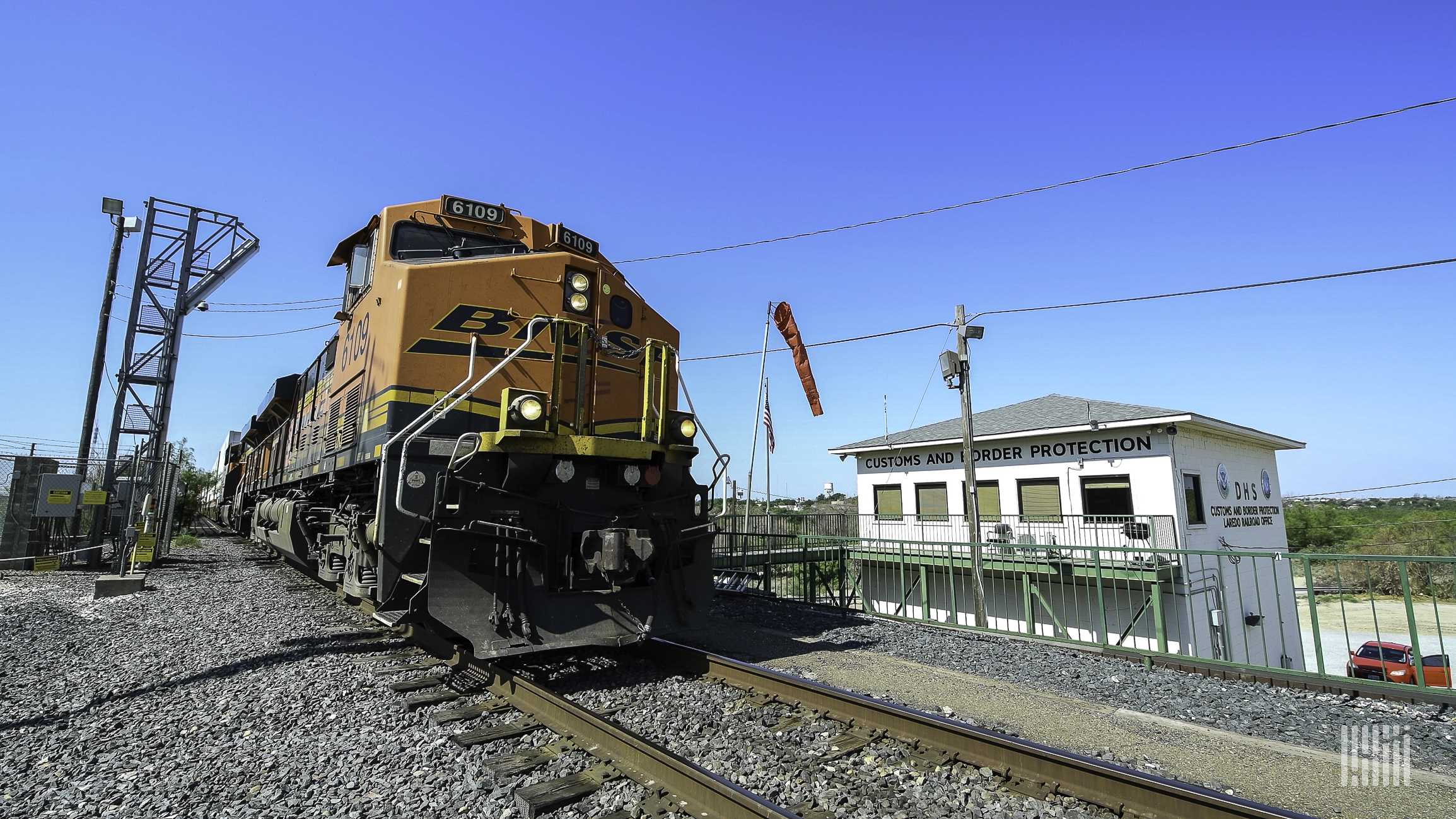 A photograph of a train by a CBP outpost.