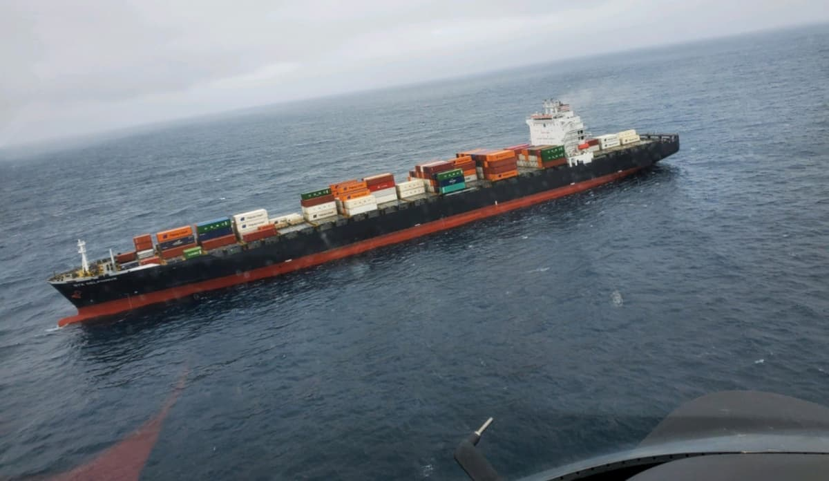 Fire-damaged container ship being towed to Port of Oakland
