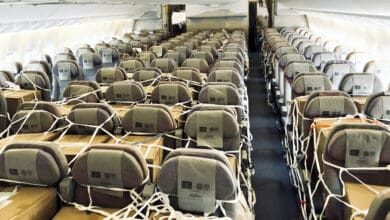 Boxes of cargo in a passenger cabin.