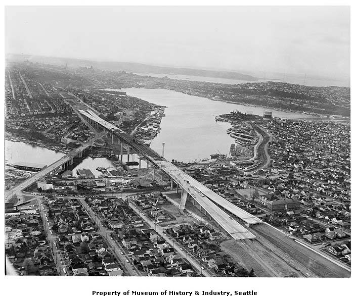 An aerial view of freeway bridge during Interstate 5 construction in Seattle, January 1961.  (Photo: University of Washington Digital Libraries collection)