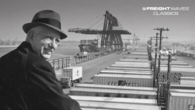 Malcom McLean looks out at a sea of containers. (Photo: americanbusinesshistory.org)