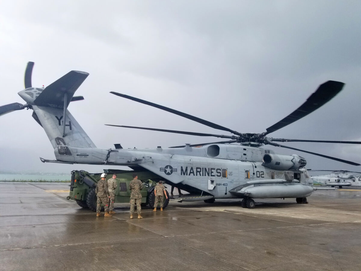 Marines load a USMC helicopter. (Photo: USMC/Staff Sgt. Frans Labranche)