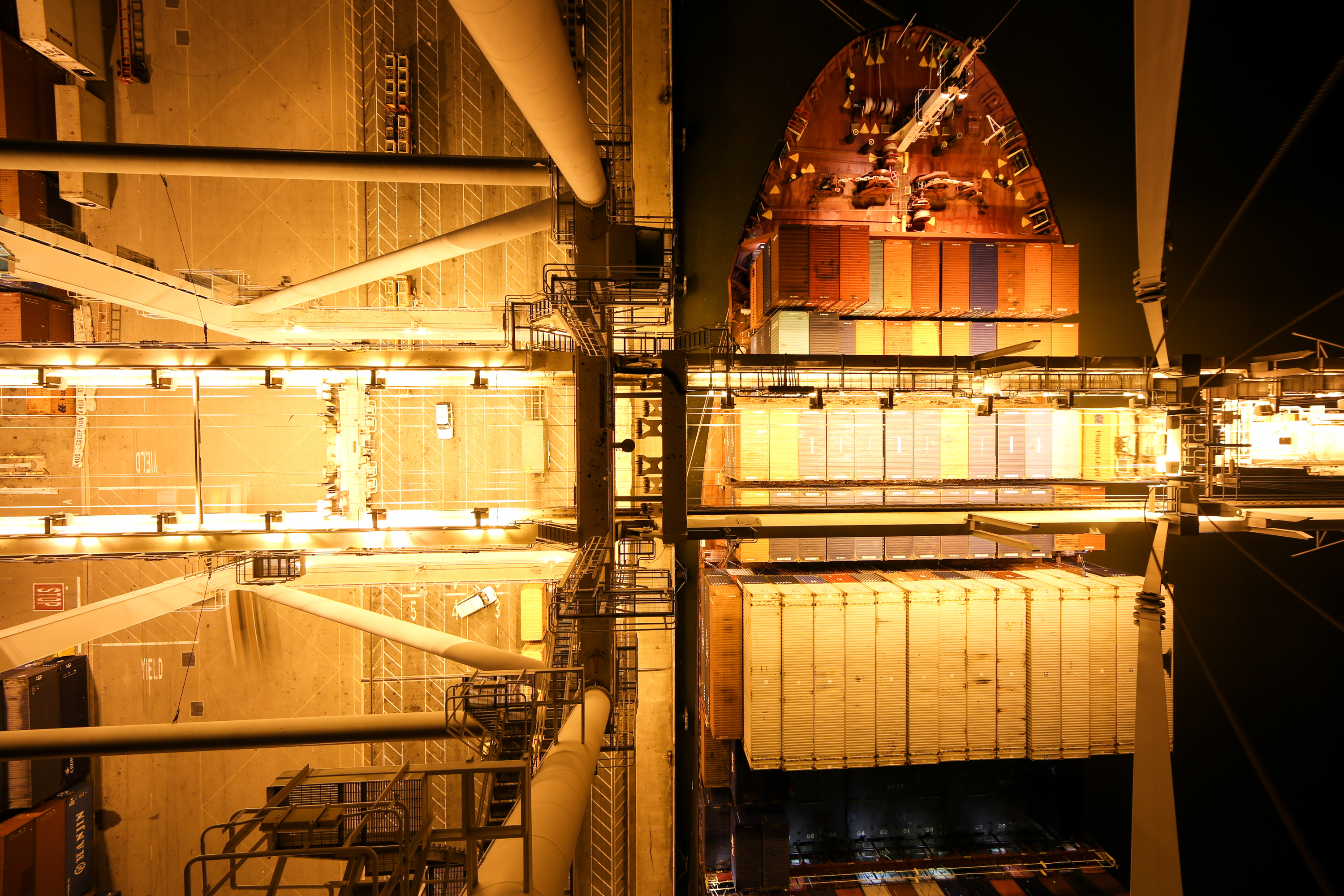 A dramatic overhead photo of a berthed container ship at night. (Photo: Port of Oakland)