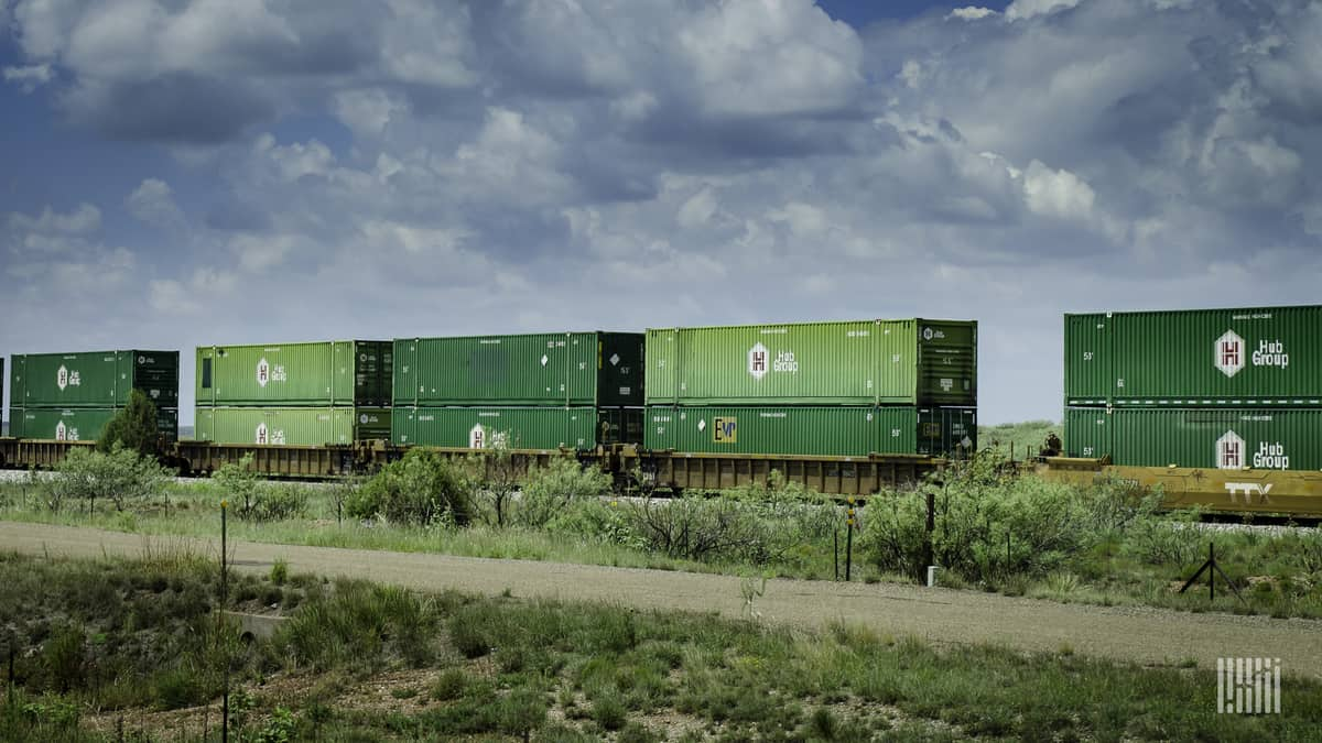 A photograph of intermodal containers double stacked on a train.