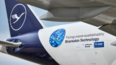 "Close up a Lufthansa aircraft tail with logo about ""shark"" skin technology for better aerodynamics."