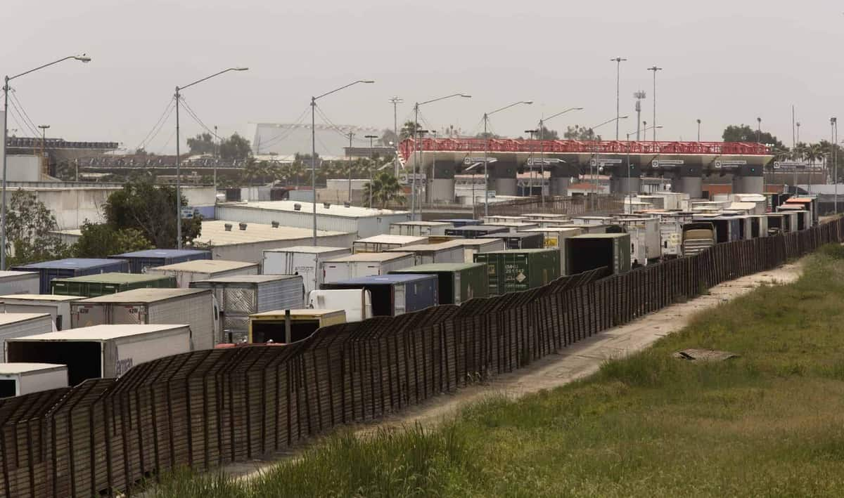 Trucks lined up on the Mexican side of the border wait to enter the United States at Otay Mesa. (Photo: Glenn Fawcett/CBP)