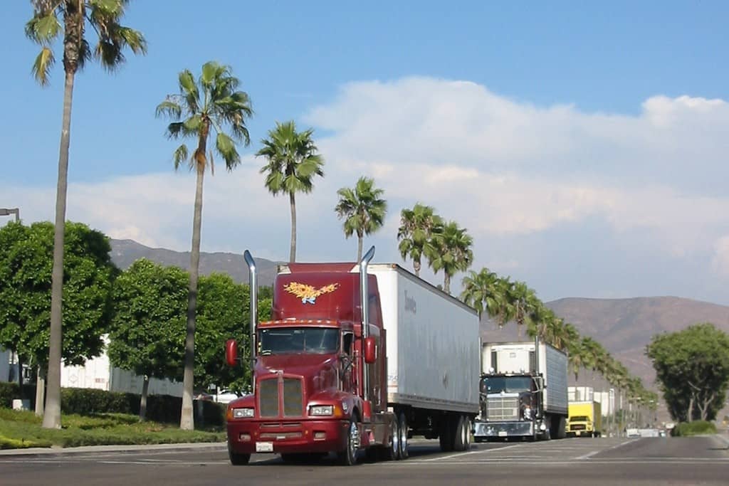 Another photo shows a long line of trucks waiting to enter the Otay Mesa LPOE and then cross into Mexico.  (Photo: Otay Mesa Chamber of Commerce)