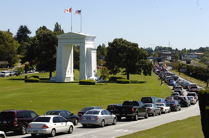 This photo shows traffic coming and going between the United States and Canada on roadways on either side of the Peace Arch. (Photo: Peace Arch News)