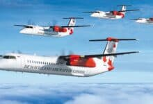 Four De Havilland turboprops fly in formation across blue sky with light clouds.