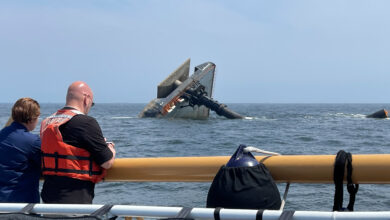 Coast Guard Unified Command team members looking at capsized SEACOR Power in Gulf of Mexico.