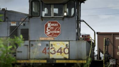 A photograph of rail equipment that has a Kansas City Southern logo on it.