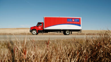 A Canada Post truck viewed from the size.