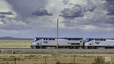 A photograph of an Amtrak train traveling through an open field.