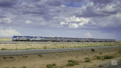 A photograph of an Amtrak train rolling down a desert field.