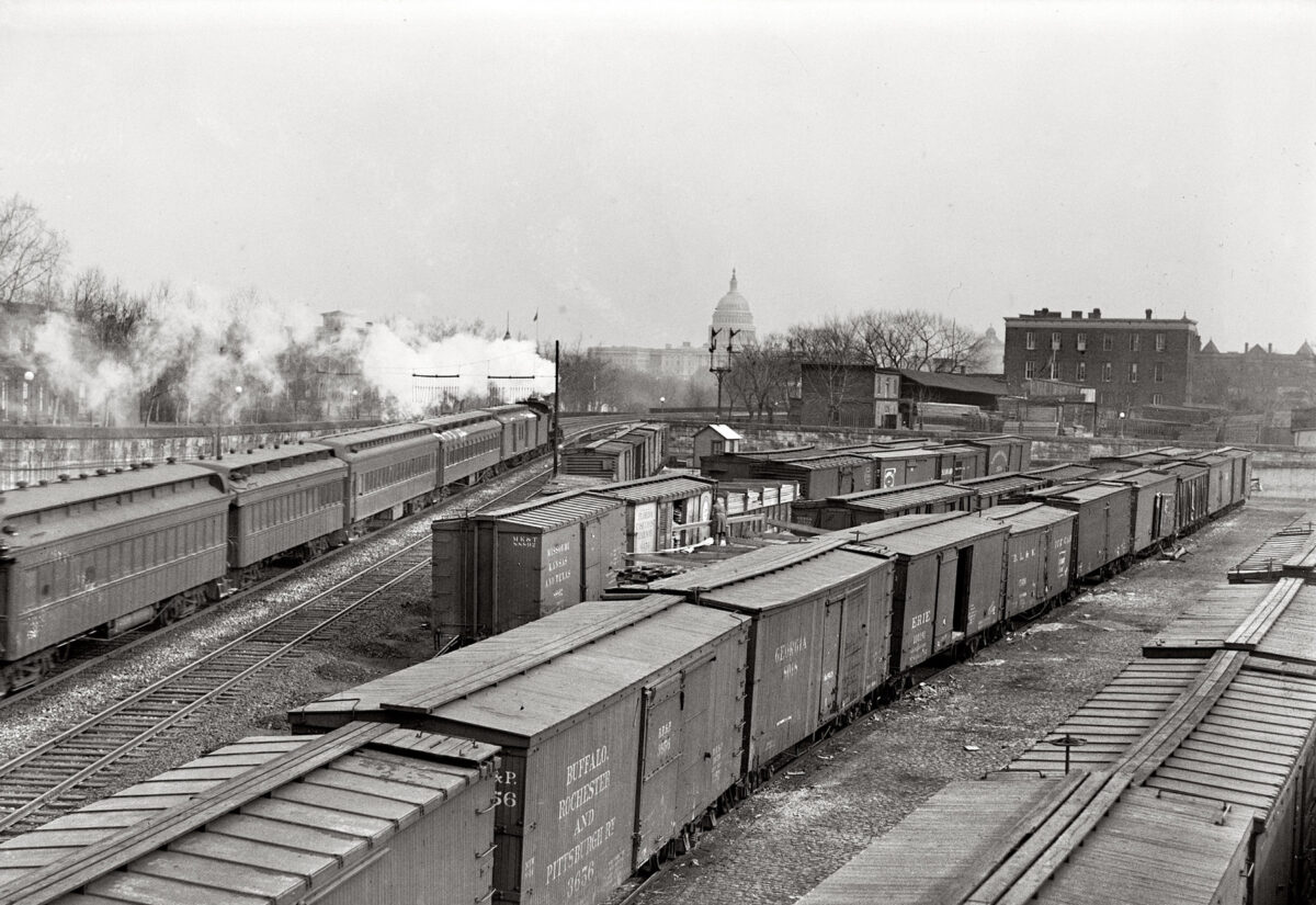 The railroad yard in Washington, D.C. in 1917. Thee are passenger trains on the left and numerous boxcars on the right. Notice the Capitol in the center of the background. (Photo: American-Rails.com)