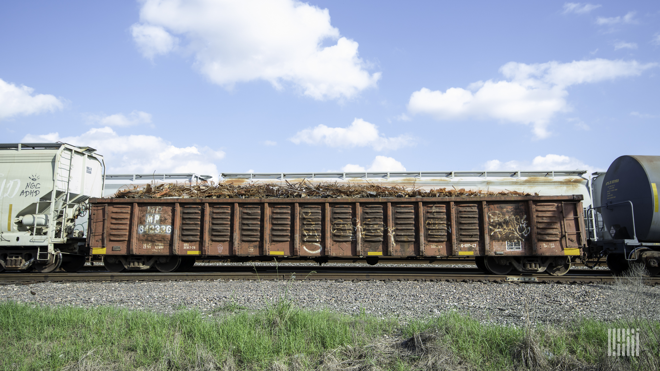 A photograph of railcars on train track.