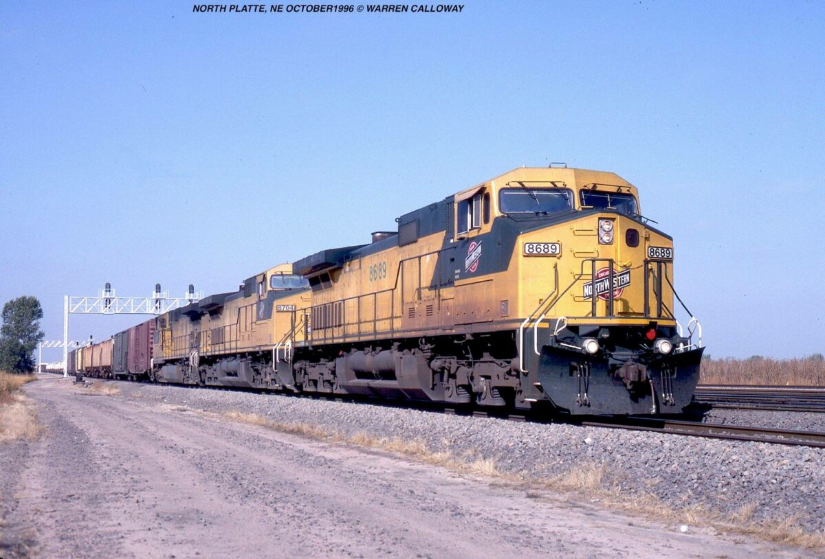 A trio of Chicago & North Western C44-9W's lead a freight train near North Platte, Nebraska shortly after the Union Pacific takeover during October 1996. (Photo: Warren Calloway)