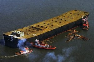 Crowley tugs help position this sea-going oil barge. (Photo: Crowley)