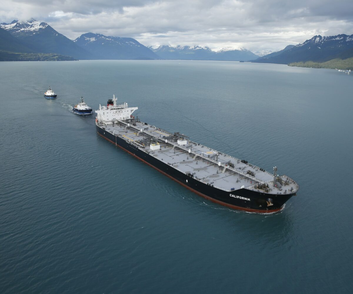A Crowley tanker sails through Alaskan waters trailed by two tugboats. (Photo: Crowley)