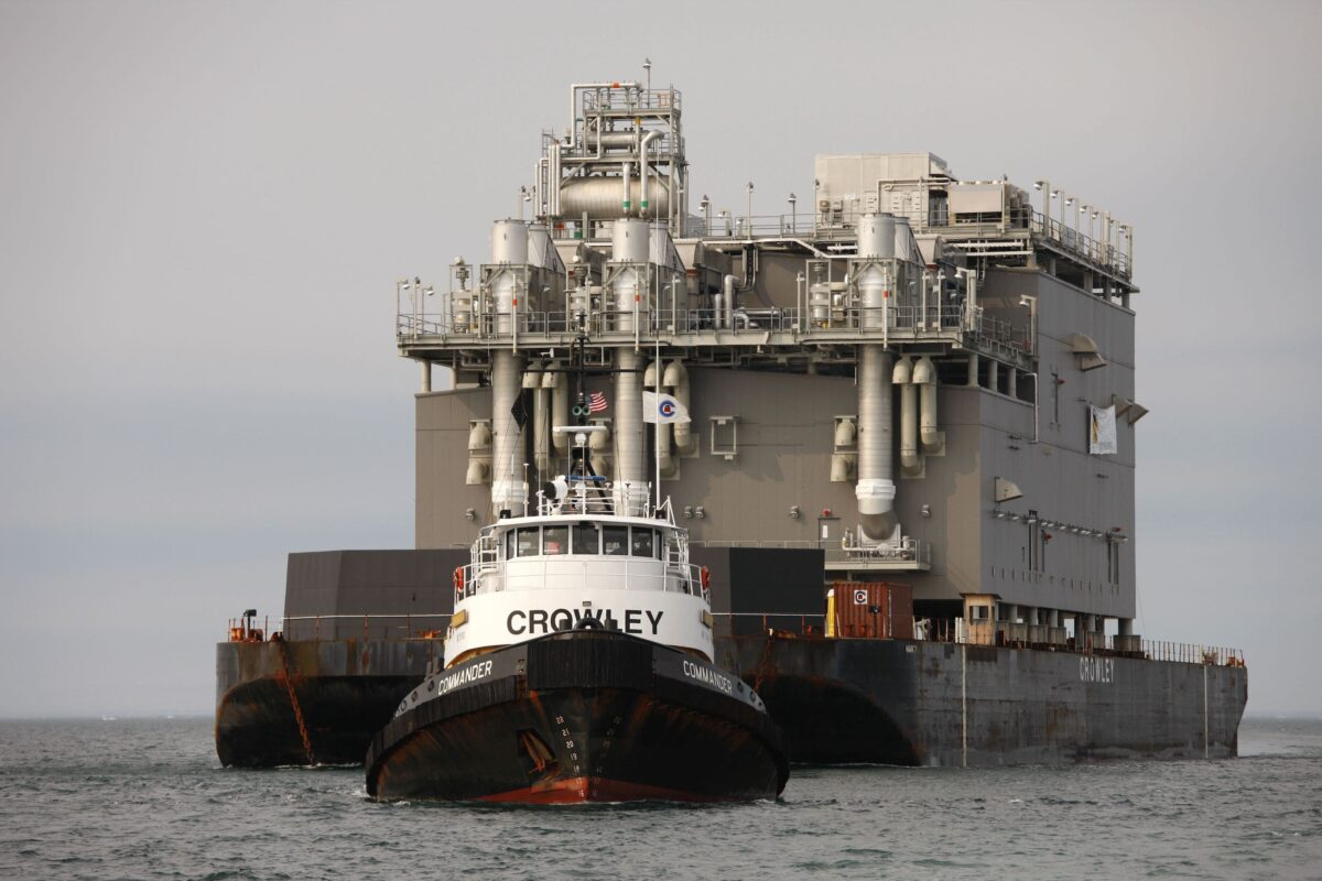 """A Crowley tug (""""Commander"""") tows this floating oil facility. (Photo: Crowley)"""