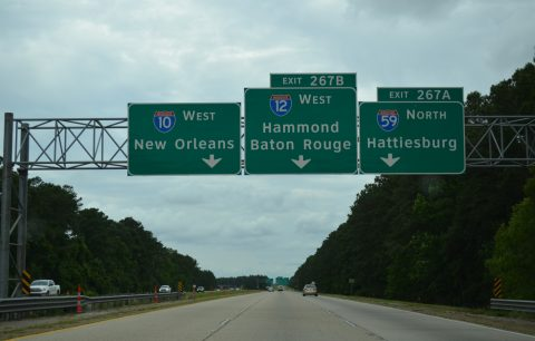 Highway signs point the way to I-10, I-12 and I-59.  (Photo: InterstateGuide.com)
