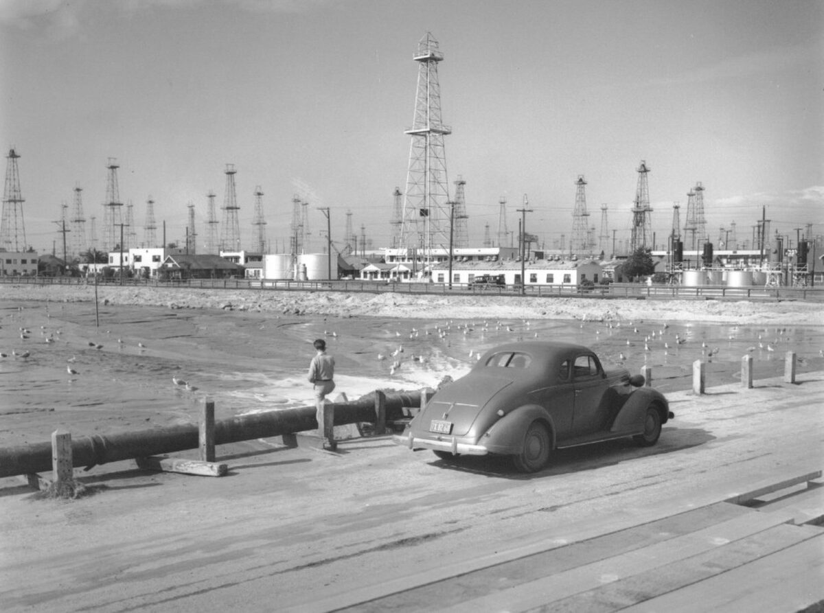 Oil wells dot the Long Beach harbor area in the late 1930s. The wells generated revenue for the City and Port but also created legal headaches and subsidence. (Photo: Port of Long Beach)