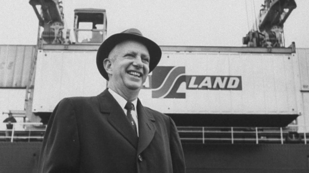 Malcom McLean, with a Sea-Land container above and behind him. (Photo: Maersk)