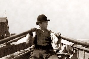 Thomas Crowley at the oars of the first Crowley ship - an 18-foot rowboat. (Photo: Crowley)