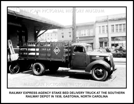 An REA stakebed delivery truck at the Southern Railroad Depot in Gastonia, NC in 1938.