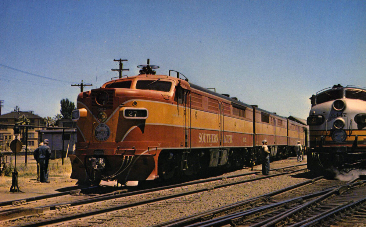 """The first and second sections of Southern Pacific's train #27, the westbound """"San Francisco Overland"""" (Chicago - San Francisco), pause at Sacramento, California in 1957. Harold Elmore photo."""