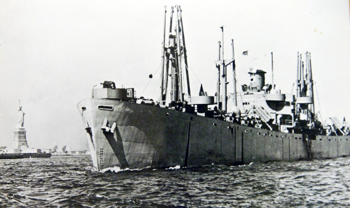 One of the ships manned by the U.S. Merchant Marine in New York harbor with the Statue of Liberty in the background. (Photo: Naval History and Heritage Command)