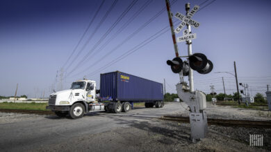 Tractor-trailer going through a railroad crossing.