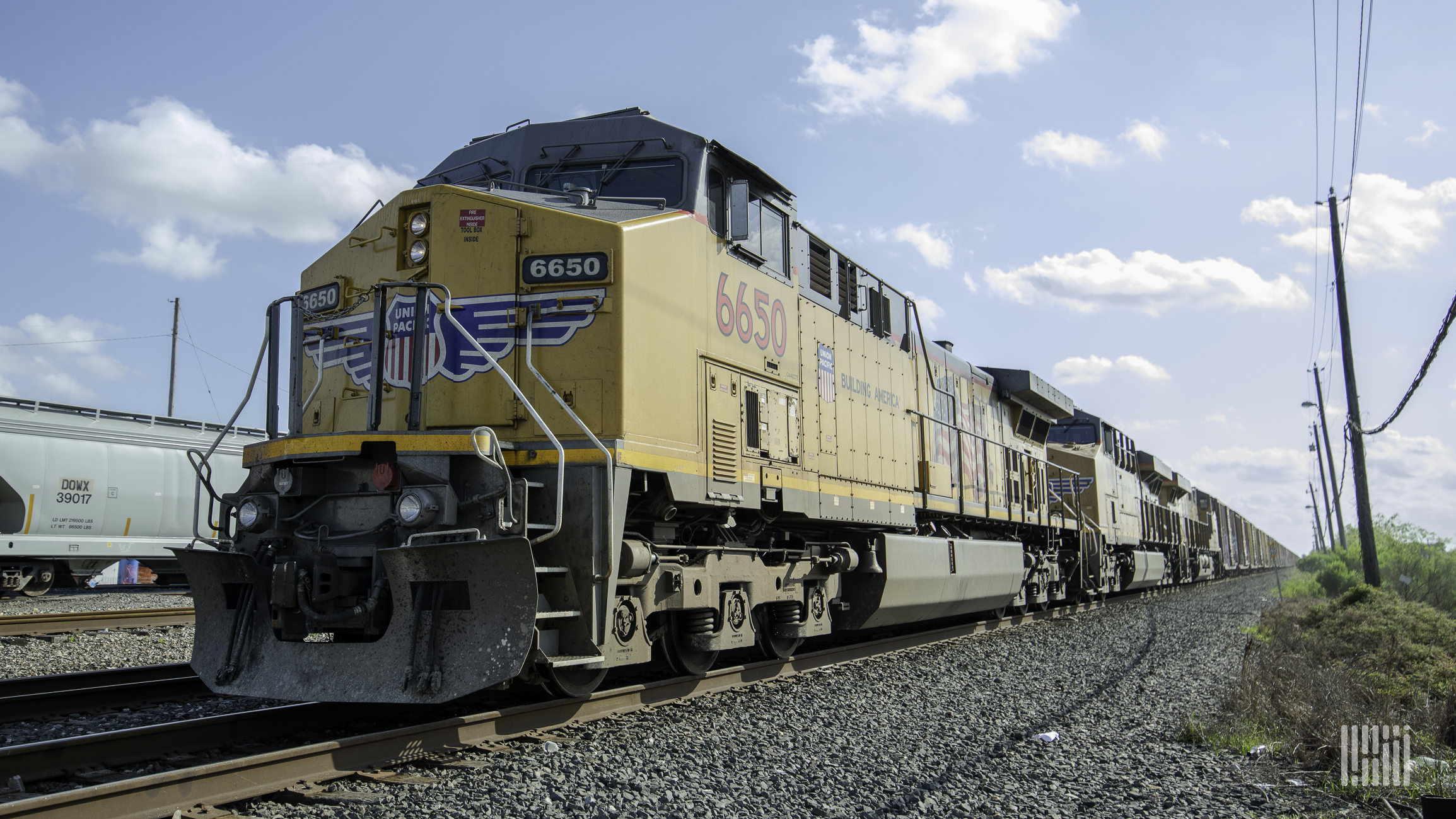 A photograph of a Union Pacific train rolling down a field.