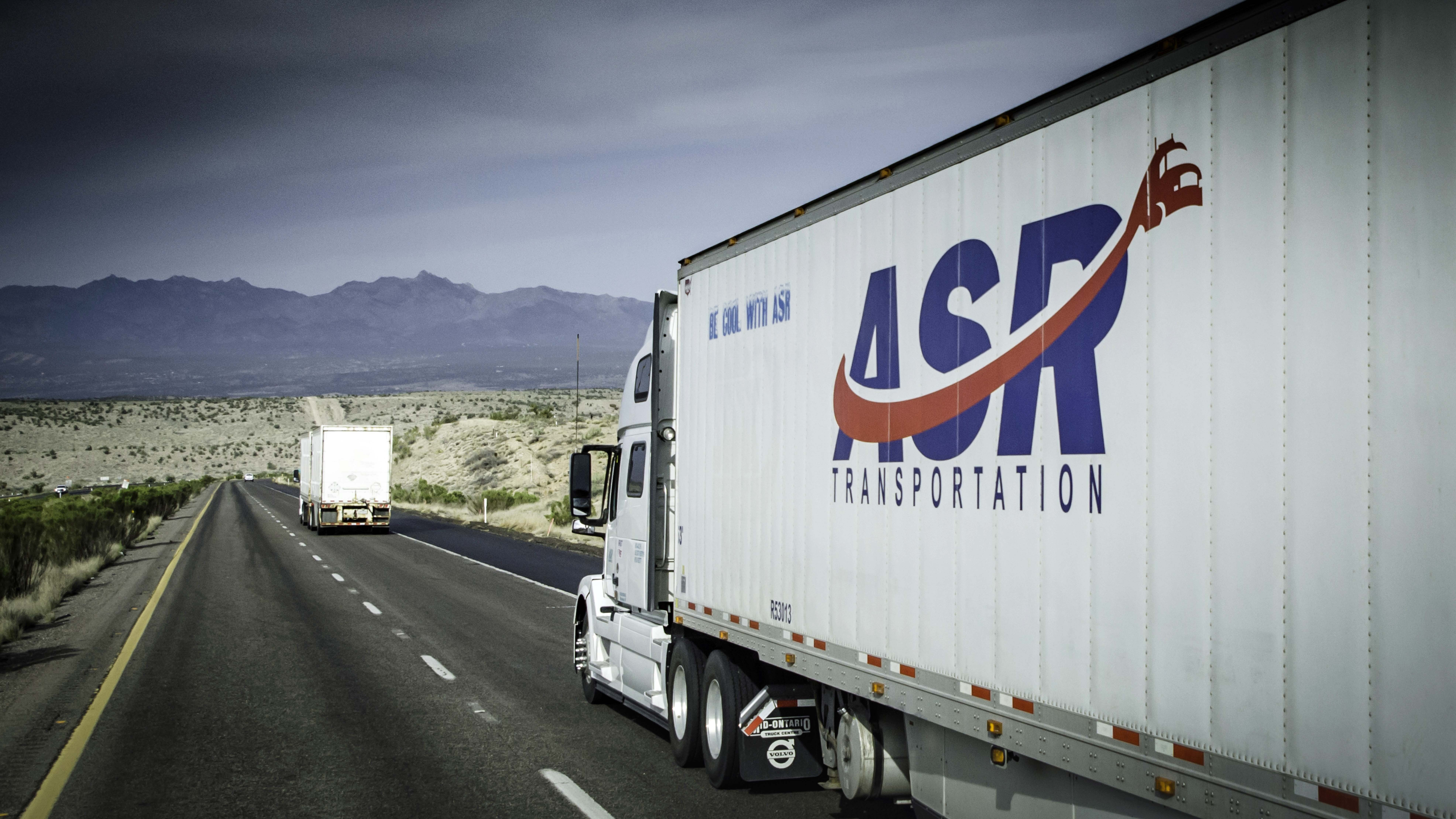 A tractor-trailer from ASR Transportation travels on a highway. The trucking company is part of legal dispute involving two brothers.