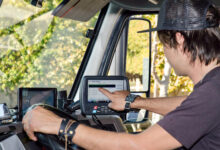 A view from inside the cab of a truck where a driver is using an ELD or electronic logging device, which whose use is required in Canada as of June 12.
