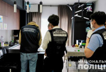 Ukrainian and South Korea police at the home of an alleged member of the Clop ransomware gang.
