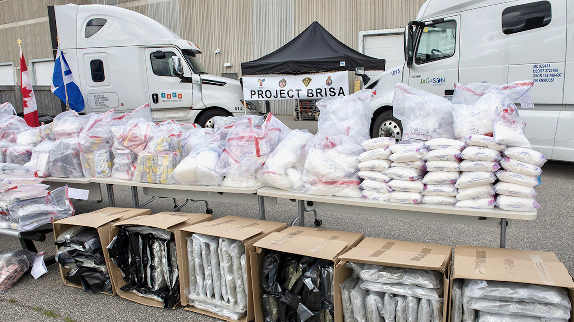 A picture of drugs and trucks seized during an investigation into drug trafficking in Canada.