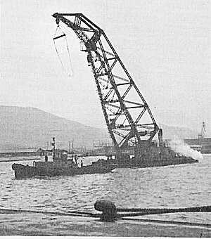 A 60-ton crane for offloading supplies is towed to Pusan in 1950. (Photo: U.S. Army)